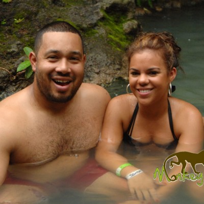 couple enjoy hot spring guachipelin