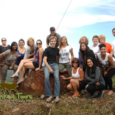 Tour group posing with an amazing lanscape