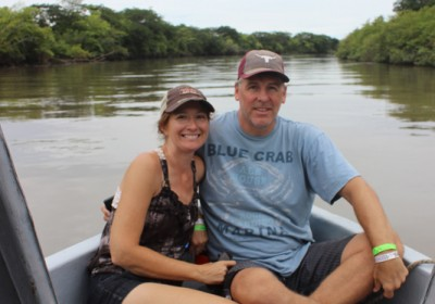 Couple having fun in the boat safari
