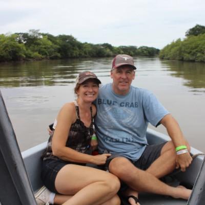 Couple having fun in the boat safari
