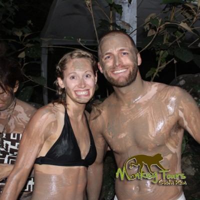 Couple in the mud bath and hot springs location in Rincon de la Vieja