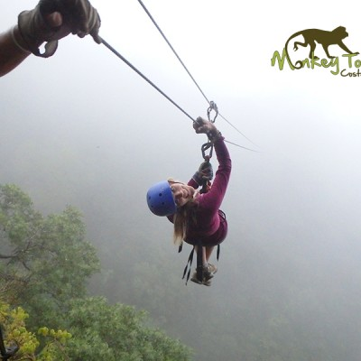 Departing the zipline with a big smile