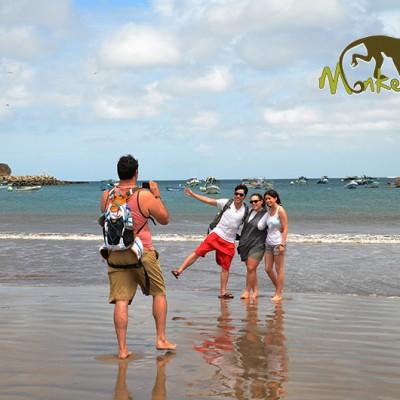 Friends having fun in the sand at the San Juan del Sur beach in Nicaragua