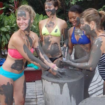 Girls enjoying a mud bath in Guanacaste Costa Rica