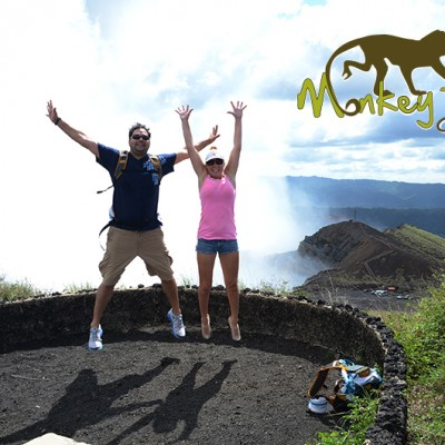 Couple jumping at a view point at the Masaya Volcano National Park in Nicaragua