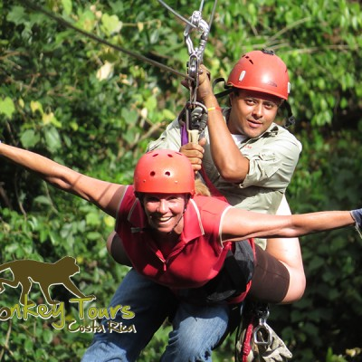 Ziplining like a bird with a guide across the forest