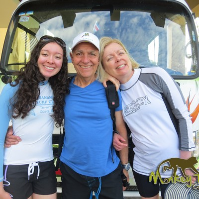 Family getting ready for a Costa Rican adventure with guided tour bus