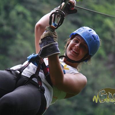 Woman zipline canopy forest Costa Rica